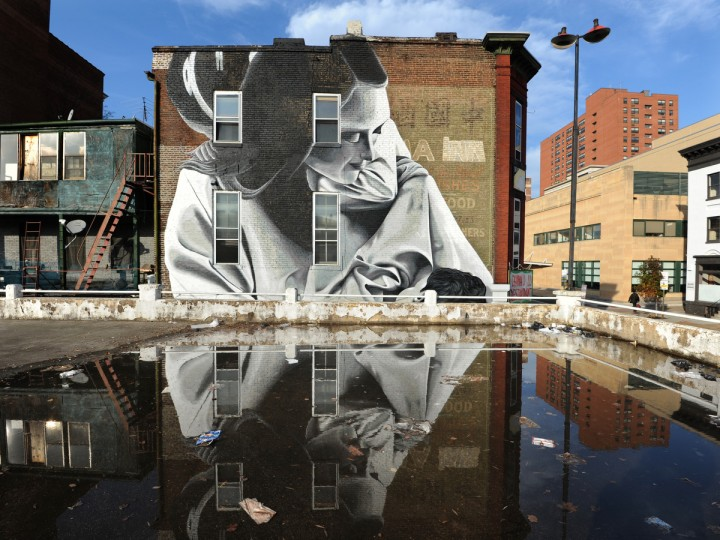 The mural of mother and child by Indigo covers the side facade of 406 Park Ave. (Articulate: Baltimore project) (Algerina Perna/Baltimore Sun)