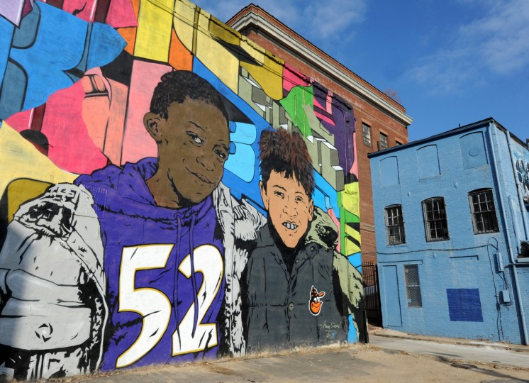 Chris Stain & Billy Mode created a mural of friends sporting their Baltimore heros' insignias. It's on the south wall of the Downtown Cultural Center at 401. N. Howasrd St. (Articulate: Baltimore project) (Algerina Perna/Baltimore Sun)