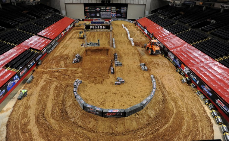 In January of most years, the 1st Mariner Arena is transformed, with the use of 1400-1500 cubic yards of dirt and heavy machinery, into an Arenacross track. (Gene Sweeney Jr./Baltimore Sun)
