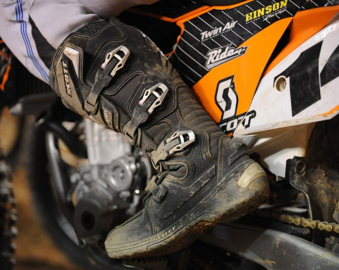 Thick soled, high boots are used by the rider to help in the banked turns, and to give protection in the close pack racing of Arenacross. (Gene Sweeney Jr./Baltimore Sun)