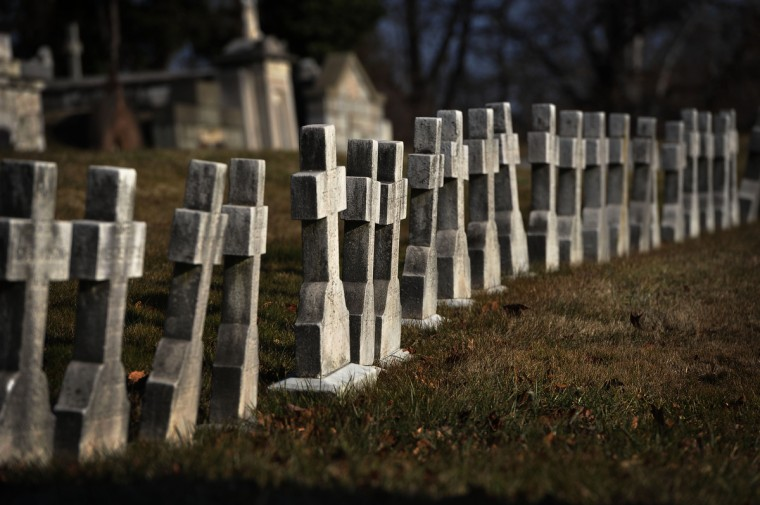 In contrast to more ornate markers, rows of simple crosses are placed on the graves of nuns in New Cathedral Cemetery on the west side of Baltimore. (Kim Hairston/The Baltimore Sun)