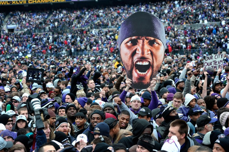 Ravens fan Gary McHugh Jr. holds up a giant Ray Lewis head during the Super Bowl victory celebration at M&T Bank Stadium. (Kim Hairston/Baltimore Sun Photo)