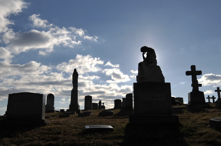 Grave markers and monuments in various forms sit on a hill on the westside of the city. (Kim Hairston/The Baltimore Sun)