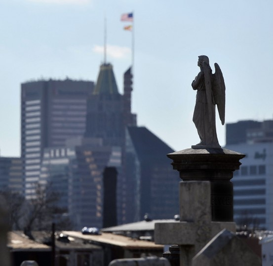 The figure of an angel gazes beyond the city from a high perch on the east side of Baltimore. (Kim Hairston/The Baltimore Sun)
