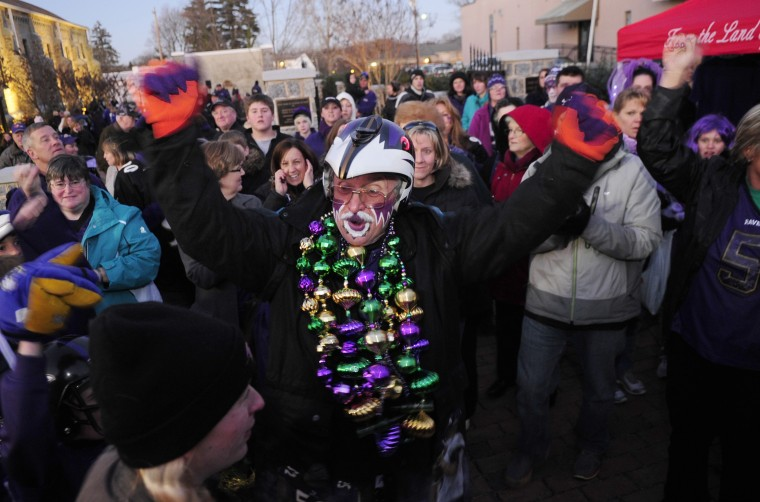 """Matt """"Fan Man"""" Andrews gets the crowd pumped up at a Ravens rally at Armory Park in Bel Air. (Matt Button/Aegis staff)"""
