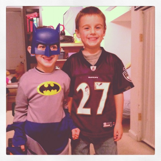 This is a shot I captured of my son and best friends son together while they played in the basement. I am a huge Baltimore Ravens fan and love the association between Ray Rice and a superhero. (Credit: John David Brock)