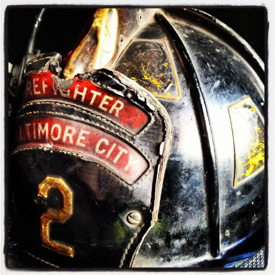 This is a shot of a Baltimore City firefighters helmet that was resting on the seat of the fire truck. My kids always like to stop and visit the firehouse when we pass by and the firefighters love the visits. (Credit: John David Brock)