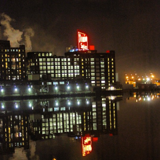 A shot captured from Fells Point of the Domino Sugar manufacturing plant. The air was very tranquil that evening and perfectly mirrored the reflection of the lights off the water. (Credit: John David Brock)