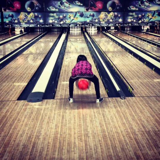 This photo was snapped over the Christmas Holiday when some of my family when to a local kids fun center. My daughter loves to bowl and 'granny' style is the only way to get the ball down the lane. (Credit: John David Brock)
