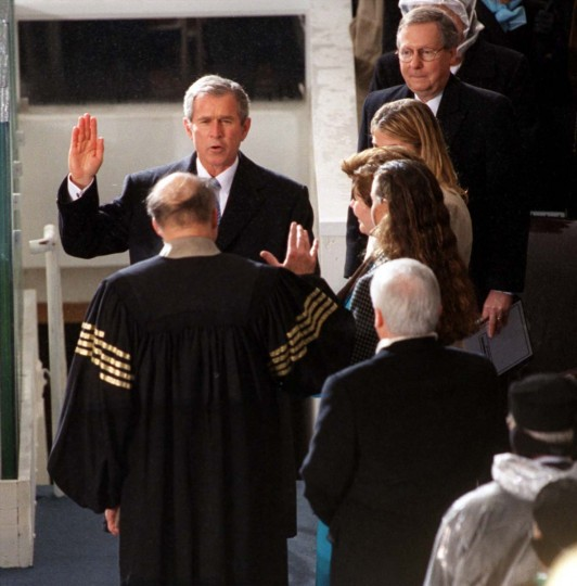 January 20, 2001 — President George W. Bush is sworn in as President of the United States by Chief Justice William Rehnquist on the west side of the Capitol. (Jerry Jackson/Baltimore Sun)