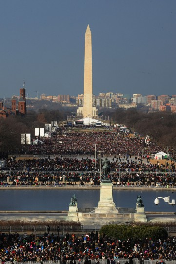 Crowds gather on the mall hours before the inauguration ceremony is scheduled to begin. (Oliver Douliery/MCT)