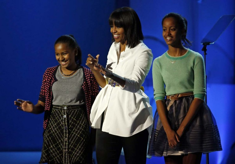 First lady Michelle Obama, flanked by Sasha and Malia, attend the Kids Inaugural Concert at the Convention Center in Washington, D.C., Saturday, January 19, 2013. (Brian Cassella/Chicago Tribune/MCT)