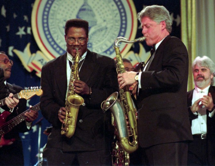 January 20, 1993 — President Clinton and Everett Harp play their saxophones during the Arkansas Ball on Inauguration evening at Washington's Convention center, Jan. 20, 1993. (Greg Gibson/AP File Photo)