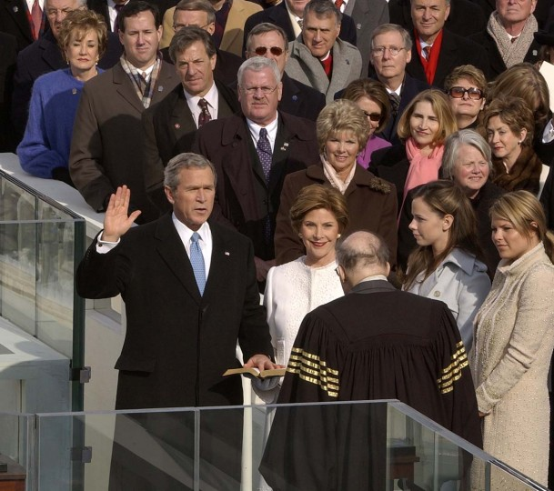 January 20, 2005 — Chief Justice Willam Rehnquist administers the oath of office to President George W. Bush, as First Lady Laura Bush and daughter Barbara and Jenna look on. (John Makely/Baltimore Sun)
