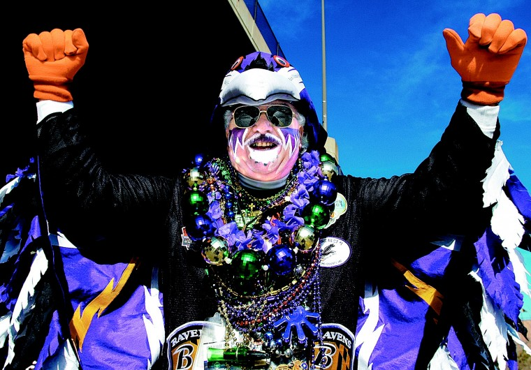 Fan Man purple and feathers himself before every home game. (File photo)