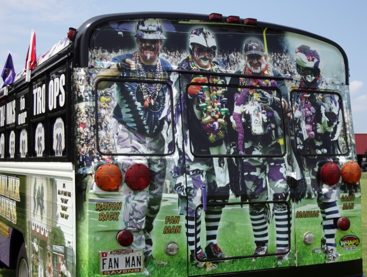 The back of the fan bus. From the left, Ravin' Rick, Fan Man, Maniac and Camo Man. (Photo courtesy of Matt Andrews)