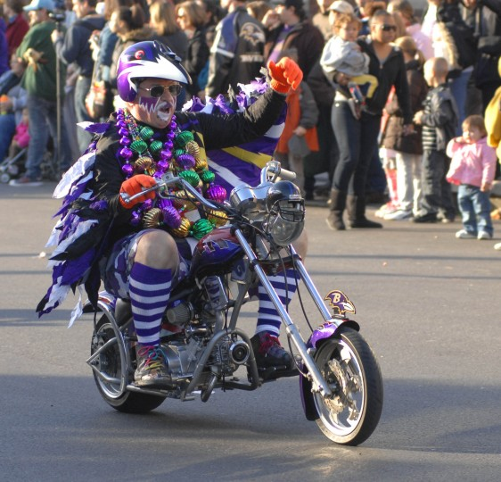 Fan Man rides his motorcycle down 36th Street during the 39th Annual Mayor's Christmas Parade in Hampden on Sunday, Dec. 4, 2011. (Photo by Karen Jackson)