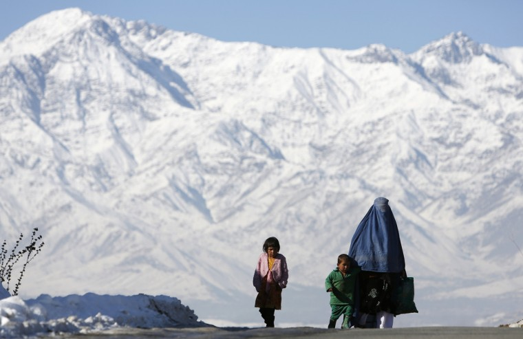An Afghan family walks on a road in winter on the outskirts of Kabul. (Mohammad Ismail/Reuters)