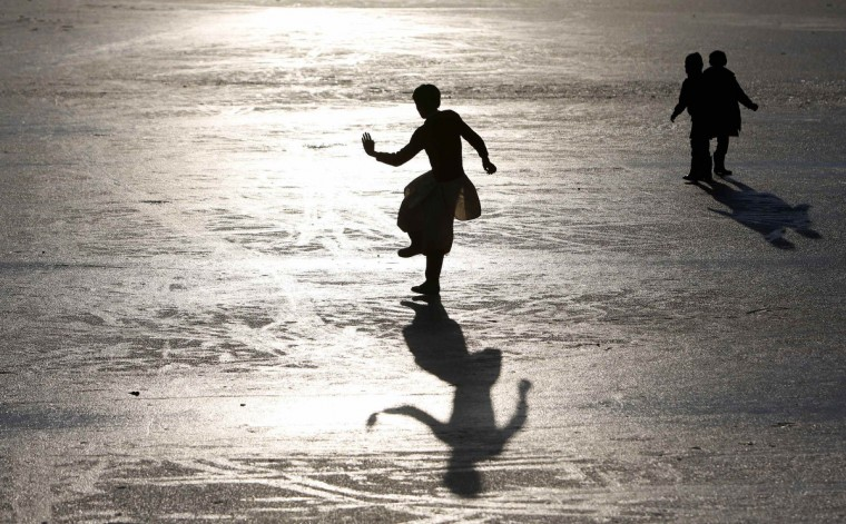 Afghan boys play on a frozen lake in Kabul. (Mohammad Ismail/Reuters)