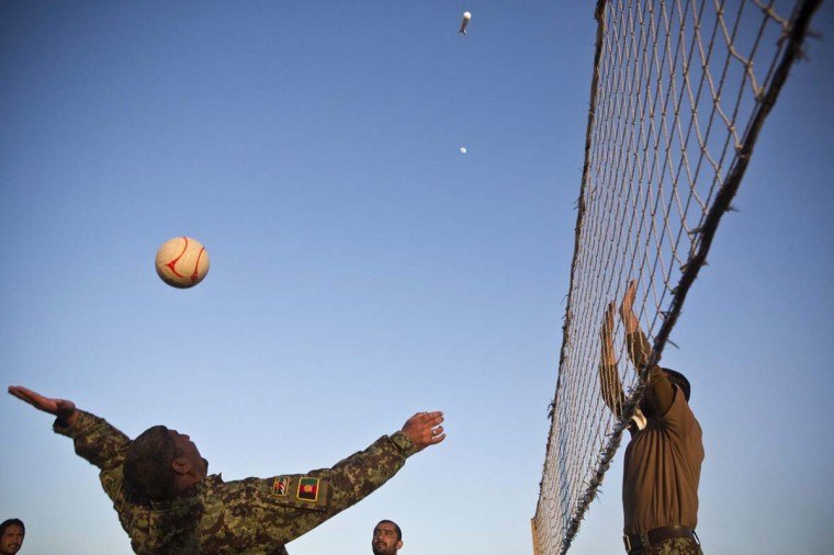 Soldiers in the Afghan National Army relax by playing volleyball at Forward Operating Base Azizullah in Maiwand District, Kandahar Province, Afghanistan, January 22, 2013. (Andrew Burton/Reuters)