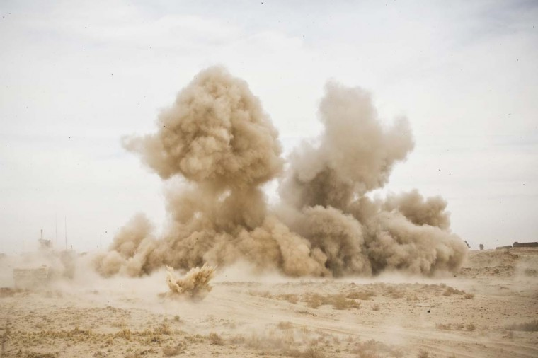 An improvised explosive device (IED) detonates underneath a vehicle during a patrol outside Command Outpost AJK (short for Azim-Jan-Kariz, a near-by village) in Maiwand District, Kandahar Province, Afghanistan, January 28, 2013. No one was killed in the attack. (Andrew Burton/Reuters)