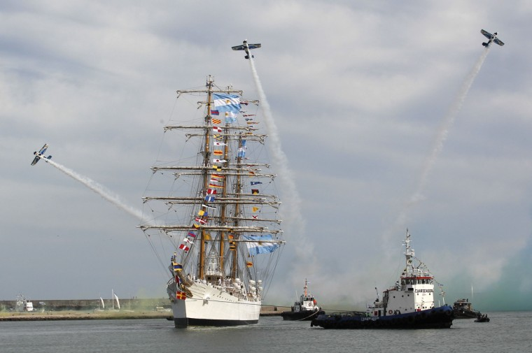 Acrobatic aircrafts perform as Argentine navy vessel ARA Libertad arrives at the harbor of the seaside resort of Mar del Plata. The tall sailing ship used for training was detained in Ghana since October 2, 2012 at the request of a hedge fund seeking payment on defaulted government bonds. It was later released and left Ghana on December 19, 2012 for Mar del Plata following a ruling by the International Tribunal for the Law of the Sea that Ghana should release the ship after Argentina argued that a U.N. Convention on the law gives warships immunity from civil claims when they dock at foreign ports. (Enrique Marcarian/Reuters)