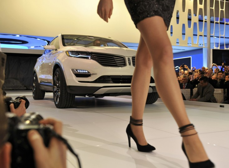 A model walks ahead as the Lincoln MKC Concept vehicle is presented at the North American International Auto Show in Detroit, Michigan. (James Fassinger/Reuters photo)