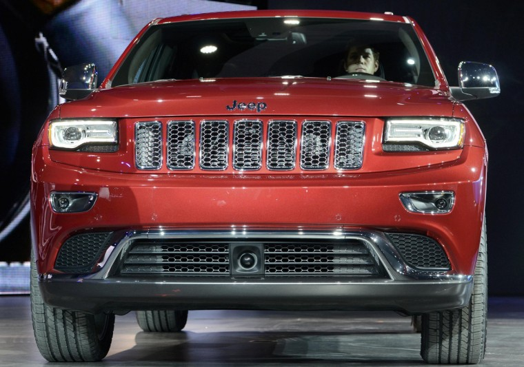 The 2014 Jeep Grand Cherokee is introduced at the North American International Auto Show in Detroit, Michigan. (James Fassinger/Reuters photo)