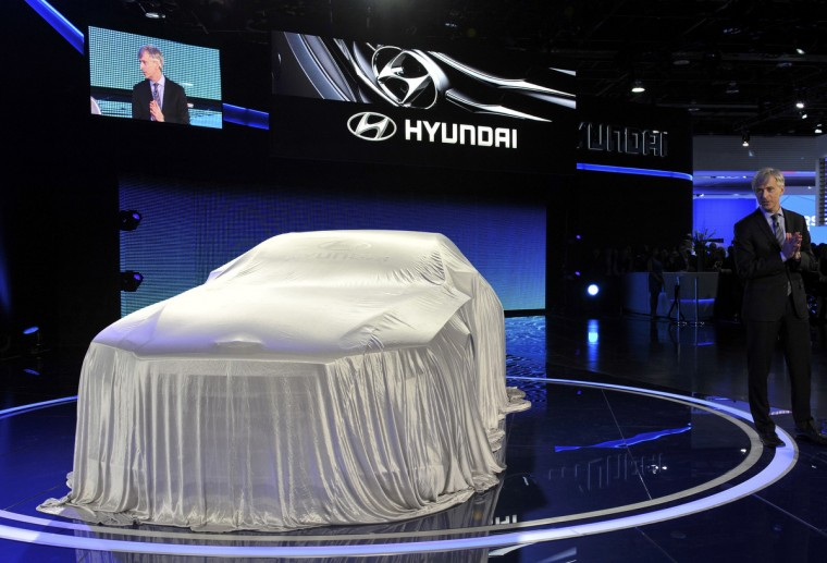 John Krafcik, President and Chief Executive Officer for Hyundai Motor America, gets ready to unveil the HCD14 luxury concept at the North American International Auto Show. (James Fassinger/Reuters photo)