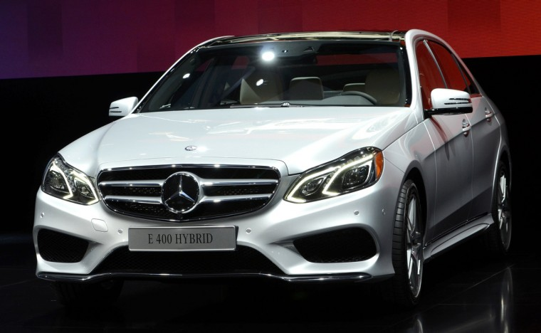 The 2014 Mercedes Benz E Class 400 hybrid is presented at the North American International Auto Show in Detroit, Michigan. (James Fassinger/Reuters photo)