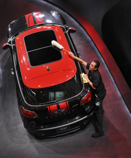 Luis Martinez, of Cosmetic Car Care, dusts off a Mini John Cooper Works Paceman before the start of the second press day at the North American International Auto Show in Detroit, Michigan. (James Fassinger/Reuters photo)