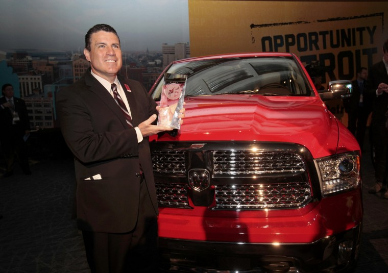 "Fred Diaz, CEO of Chrysler's Ram Division, poses with a Ram pickup truck after it won the ""North American Truck of the Year"" award at the North American International Auto Show in Detroit, Michigan. (Rebecca Cook/Reuters photo)"