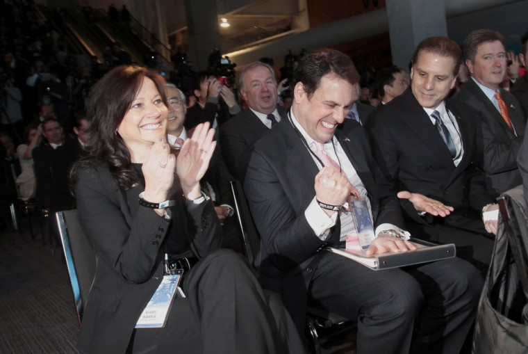 "General Motors North America President Mark Reuss (C) celebrates after the Cadillac ATS was announced as the winner of the ""North American Car of the Year"" award at the North American International Auto Show in Detroit, Michigan. (Rebecca Cook/Reuters photo)"