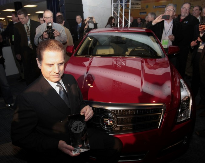 "Dave Leone, Chief Engineer for Cadillac, poses with an ATS after it won the ""North American Car of the Year"" award at the North American International Auto Show in Detroit,. (Rebecca Cook/Reuters photo)"