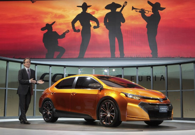 Bill Fey, Group Vice President and General Manager of Toyota Division, speaks next to the Toyota Corolla Furia concept at the North American International Auto Show in Detroit, Michigan. (Rebecca Cook/Reuters photo)