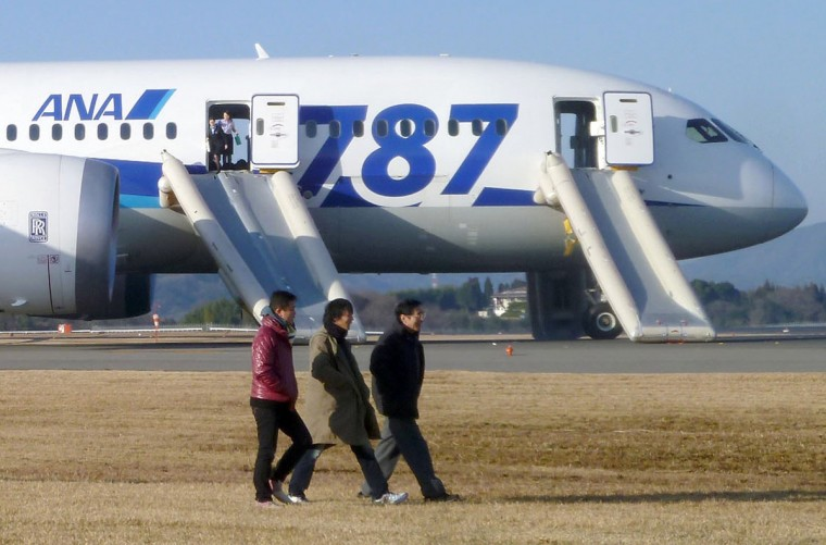 Passengers walk away from All Nippon Airways' (ANA) Boeing Co's 787 Dreamliner plane which made an emergency landing at Takamatsu airport, western Japan, as seen in this photo taken by a passenger and distributed by Japan's Kyodo. A Boeing 787 operated by All Nippon Airways Co made an emergency landing in Takamatsu in western Japan after smoke appeared in the plane's cockpit, but all 137 passengers and crew members were evacuated safely, the Osaka Airport said on Wednesday. (Kyodo)