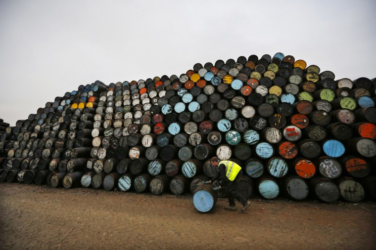 A workman moves a barrel in front of stow of casks at the Speyside Cooperage in Craigellachie in Speyside, Scotland. The cooperage, operating since 1947, repairs and makes over 100,000 oak whisky casks and barrels per year. The Scotch whisky industry said it exported 40 bottles per second in 2011 and it is now Scotland's largest international export ahead of refined petroleum (£3.0 billion) and business services (£2.5 billion). (David Moir/Reuters)