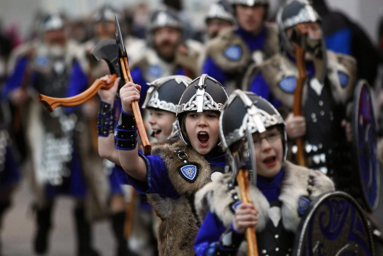 Young Jarl Squad vikings shout as they march through the streets on the morning of the Up Helly Aa fire festival in Lerwick, Shetland Islands, Scotland. The Up Helly Aa festival, introduced by men returning from the Napoleonic Wars of the early 19th century, takes place annually on the last Tuesday of January. (David Moir/Reuters)