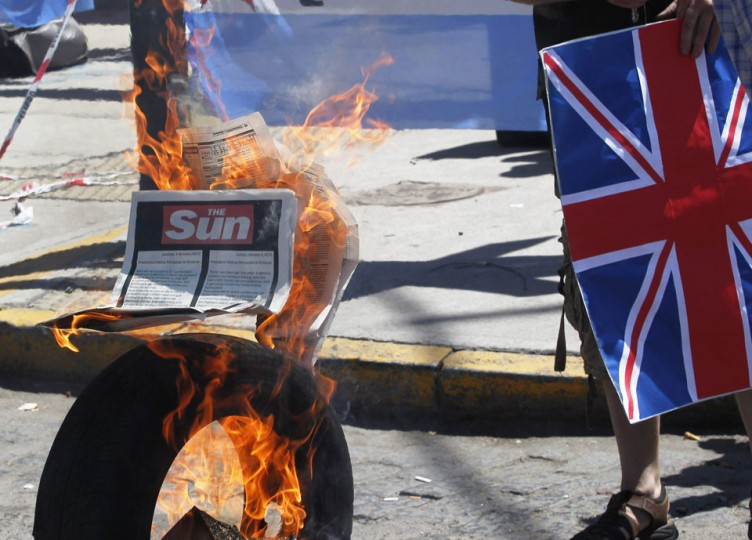 Left-wing activists burn an advert taken out by British tabloid newspaper The Sun, that defends Britain's right to govern the Falkland Islands, which is published on page 5 of the English-language Buenos Aires Herald, during a protest at the Buenos Aires cruise terminal. Britain rejected calls on Thursday from Argentine President Cristina Fernandez for talks over the disputed Falkland Islands after she wrote an open letter to Prime Minister David Cameron. Britain and Argentina fought a 10-week war in 1982 over the remote South Atlantic islands, which are part of Britain's self-governing overseas territories and are known in Argentina as Las Malvinas. (Enrique Marcarian/Reuters)