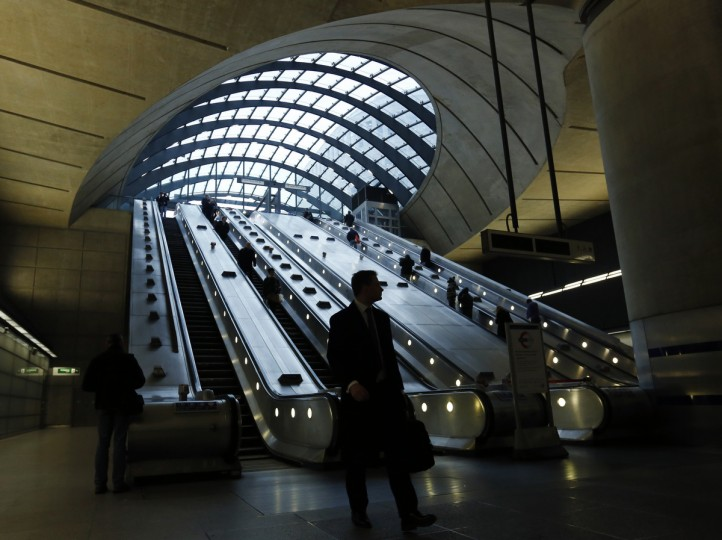 Passengers arrive at Canary Wharf underground station in London. Britain's capital began year-long celebrations for the 150th anniversary of the world's oldest underground passenger railway on Wednesday with reams of newsprint and plans for exhibitions, books, poetry and a commemorative steam train ride. (Olivia Harris/Reuters photo)