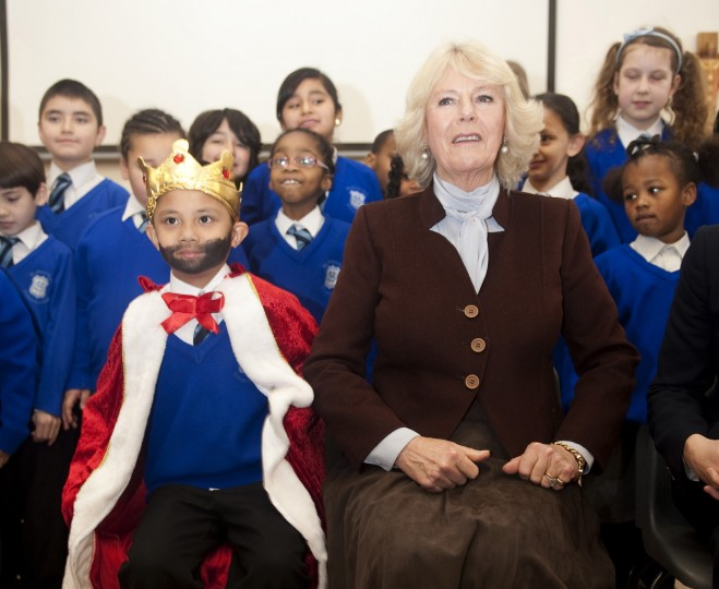 Britain's Camilla, Duchess of Cornwall sits with schoolchildren during a visit to St Mary's R. C. Primary School in London. (Jeremy Selwyn/Reuters)