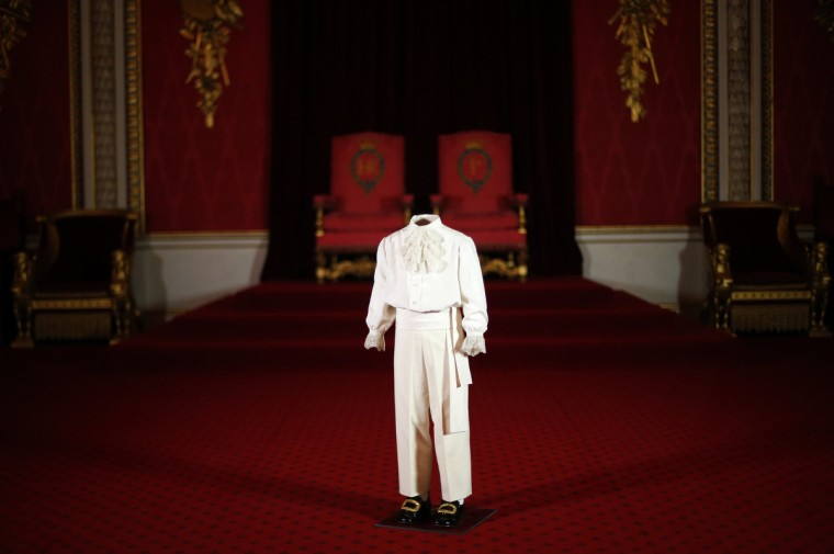 The suit worn by Britain's then-four year old Prince Charles on the day of his mother Queen Elizabeth's coronation is displayed in the throne room at Buckingham Palace during a media preview of this summer's exhibition, in central London. This summer's Buckingham Palace exhibition will commemorate the 60th anniversary of Queen Elizabeth's coronation with a collection of dresses, uniforms and robes worn on the day. (Andrew Winning/Reuters)