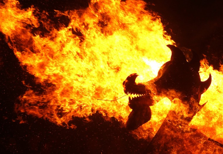 Flames engulf the dragon's head on a viking longboat as it is set on fire during the Up Helly Aa fire festival in Lerwick, Shetland Islands, Scotland. The Up Helly Aa festival, introduced by men returning from the Napoleonic Wars of the early 19th century, takes place annually on the last Tuesday of January. (David Moir/Reuters)