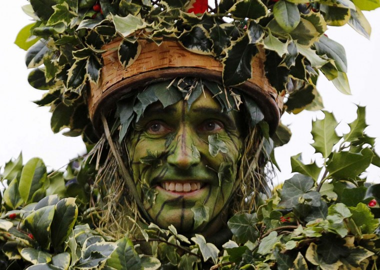 An actor portraying the Holly Man arrives by rowboat at Shakespeare's Globe Theatre on the South Bank of the Thames River, during Twelfth Night celebrations in London January 6, 2013. A troupe of actors took part in Wassailing, an ancient English tradition with the purpose of waking the apple trees and scaring away evil spirits, in order to ensure there will be a good harvest the next autumn. (Chris Helgren/Reuters)
