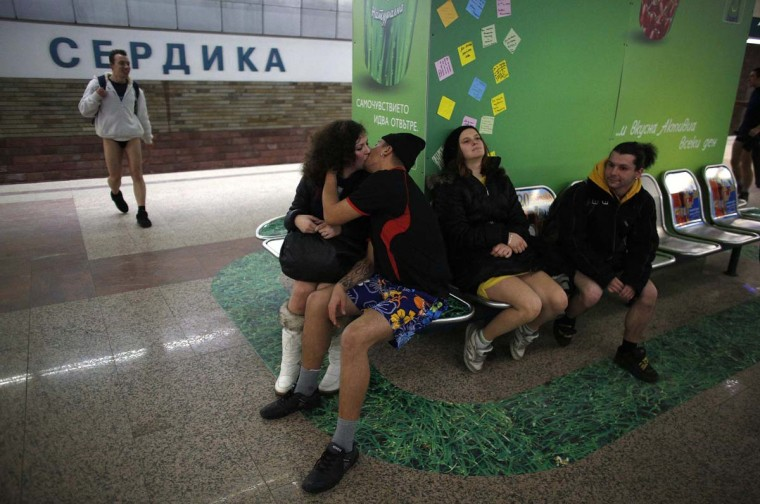 "A couple kisses as people who are not wearing pants wait on the subway station during the annual ""No Pants Subway Ride"" in Sofia January 13, 2013. The event, organised by Improv Everywhere, involves participants who strip down to their underwear as they go about their normal routine. (Stoyan Nenov/Reuters)"