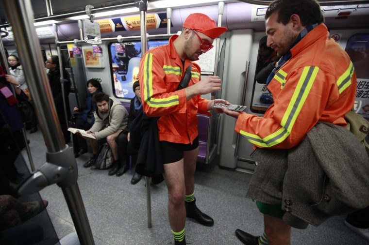 "Two men not wearing pants play chess on the subway during the annual ""No Pants Subway Ride"" in Shanghai January 13, 2013. The event, organised by performance art group Improv Everywhere, involves participants who strip down to their underwear as they go about their normal routine. (Aly Song/Reuters)"