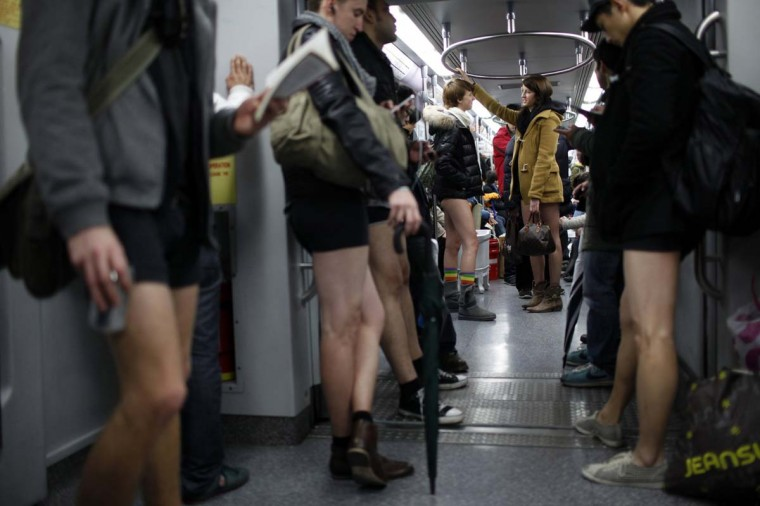 "People take part in the annual ""No Pants Subway Ride"" in Shanghai January 13, 2013. The event, organised by performance art group Improv Everywhere, involves participants who strip down to their underwear as they go about their normal routine. (Aly Song/Reuters)"