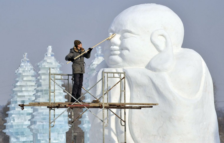 A man polishes a snow sculpture in preparation for Shenyang International Ice and Snow Festival, Liaoning province, China. The festival kicks off on January 10, local media reported. (Stringer/Reuters)