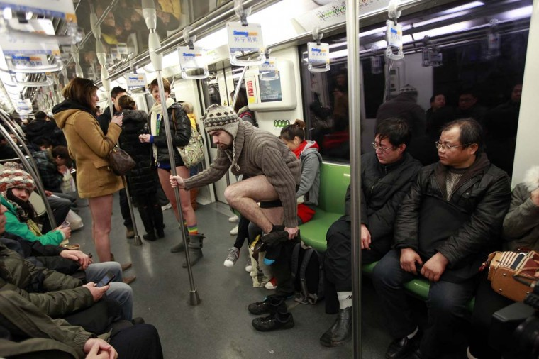 "Passengers react to seeing a man take off his pants, on the subway during the annual ""No Pants Subway Ride"" in Shanghai January 13, 2013. The event, organised by performance art group Improv Everywhere, involves participants who strip down to their underwear as they go about their normal routine. (Aly Song/Reuters)"