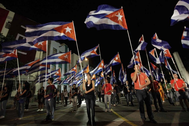 Youths holds Cuban flags during a torch march in celebration of the 160th birth anniversary of Cuba's independence hero Jose Marti, at Havana University January 27, 2013. Thousands of members from the Cuban Communist Youth Union (UJC) and student organizations participated in the march. (Enrique De La Osa/Reuters)
